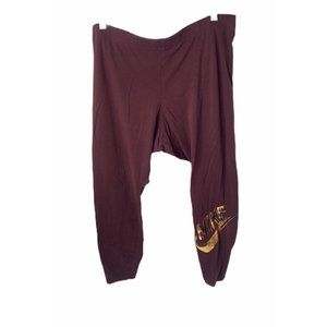 Women's size 2XL Nike plum with gold logo leggings